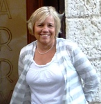 Kathy outside of Harry's Bar in Venice, Italy